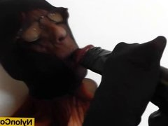 Nylon covered redhead playing with herself with toys