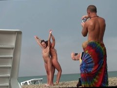 Voyeur on public beach. Girls posing
