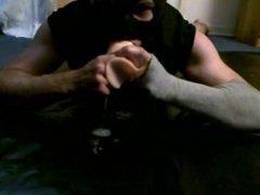 Masked boy deepthroats dildo