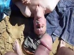nat feeds ray cock at the beach