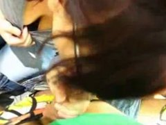 Amazing nerd chick giving blowjob in a shop