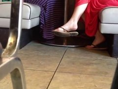 Cutie's feet and soles at restaurant.