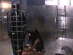 Futuristic Latex Lesbians Have Fun With Slave In A Cage