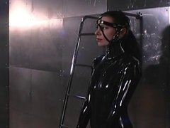 Latex Ladies Explore Restraints And Some Whipping