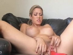 Naked Capri gets off with her big red dildo