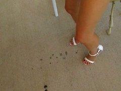 Lisa in white mini and heels