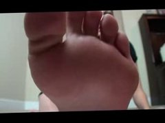 Teen shows her feet in flip flop