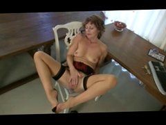 Mature milf in stockings rubbing her pussy