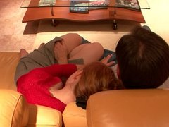 Cute redhead gets fucked on couch