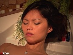Asian Teen Fucks Herself in Clear Bathtub