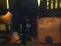 candid shoeplay at bar