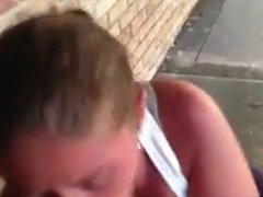 Streetwhore swallows on stairs