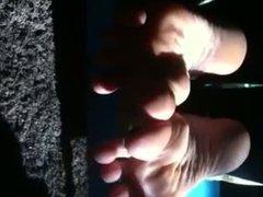 Wife toe wiggle in sun