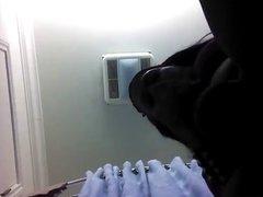 Ebony TG stroking huge cock in bathroom