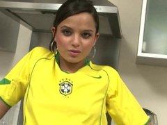 Sporty slut maturbates with a vibrator in the kitchen