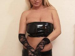 Busty blondie loves it when she takes her latex outfit off just for your pleasure