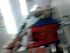 Upskirt woman in supermarket