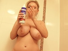 Busty blonde spreads whipped cream on her delicious bouncy tits