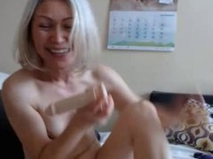 Mature fingers her bald pussy