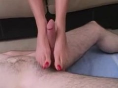 Milf gives younger man a footjob