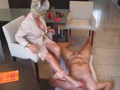 Milf gives foot & handjob