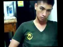 A cute Thai soldier shows his cock on cam.
