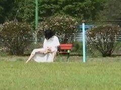 Asian MILF in public playground
