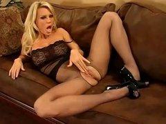 Slutty blond babe shows off her nylon legs