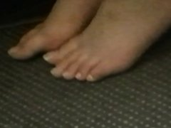candid feet in plane