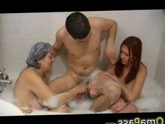 Very old chubby Granny playing with couple in bath