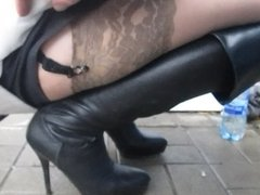 Touching her legs in stockings on the street