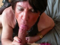 Mature CD sucking a young cock