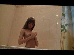 Beautiful Teenage Girl takes a shower
