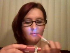 whit smoking a Virginia slim 120