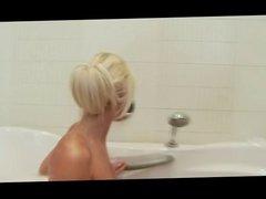 Pretty young blond masturbating in the bath tub