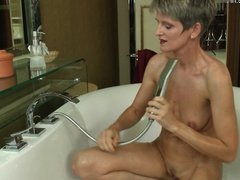 Horny skinny mother taking a naughty bath