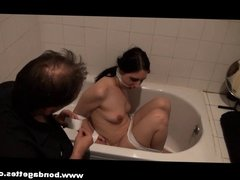 Bath bondage of submissive Honesty Cabellero in gagged