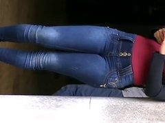The beauty and grace of a brunette in jeans  - soft