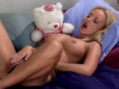 Blond uses her sex toy to masturbate