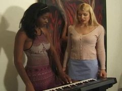 blond and black spank one another
