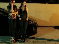 Three naughty babes strip and fuck in a parking lot