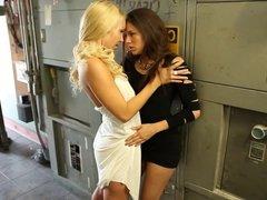 Hot blonde licks horny brunette's tight cunt in the corridor