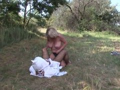 Adult baby likes his ass poked by his mummy's strap-on outdoors