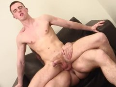 Tattooed hunk shoves toys in twink's ass before he pounds him