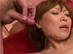 Japanese cutie gets her pussy teased and her face creamed