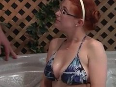 Hot redhead with glasses fucks older guy in the whirlpool