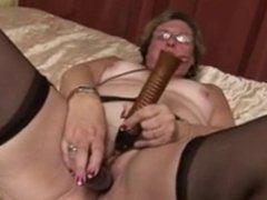 Granny masturbates with dildo and orgasm