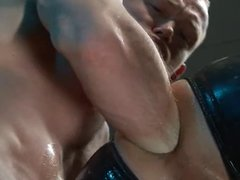 Rubber stud getting fist fucked