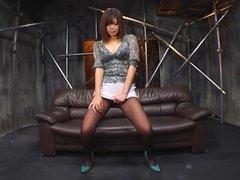 Japanese lady masterbates through panty hose.