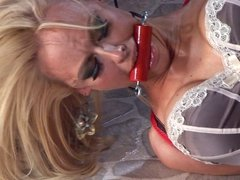 Tied blonde with red rope
